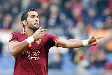 AS Roma's Benatia celebrates after scoring against Genoa during their Serie A soccer match at Olympic stadium in Rome
