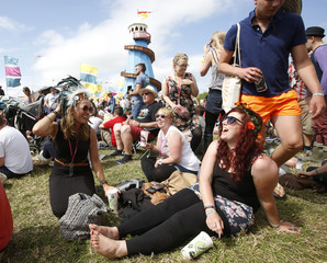 The crowd wait in the sunshine outside the tent where Bruce Forsyth will perform in the Field of Avalon at Glastonbury music festival at Worthy Farm in Somerset