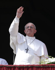 "Pope Francis waves during his ""Urbi et Orbi"" address from a balcony in St. Peter's Square at the Vatican"