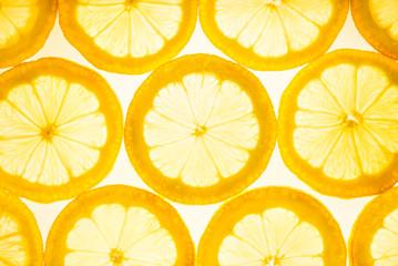 Lemon fruits top view flat lay yellow background. Lemon slices infused lemonade.