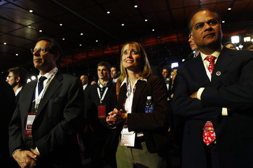 Supporters look on as they watch results at the presidential nominee Romney election night rally in Boston