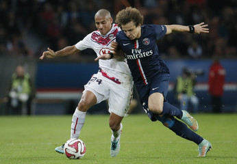 Paris St Germain's David luiz Moreira fights for the ball with Girondins Bordeaux's Wahbi Khazri during their French Ligue 1 soccer match at the Parc des Princes stadium in Paris