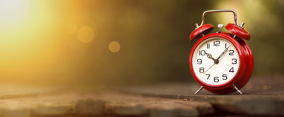 Time management concept - website banner of a vintage red alarm clock