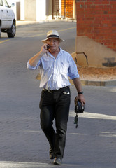 Henke, father of Oscar Pistorius, leaves after his son's bail hearing at  the Pretoria Magistrates court
