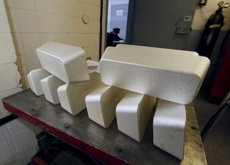 Ingots of 99.99 percent pure silver are seen placed on a table before the machining process at the Krastsvetmet Krasnoyarsk non-ferrous metals plant in the Siberian city of Krasnoyarsk, Russia