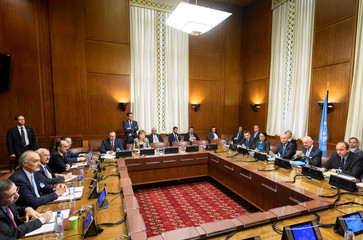 General view of a meeting between UN Special Envoy for Syria and the Syrian government delegation during Syria peace talks, at the European headquarters of the United Nations in Geneva