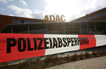 A barrier tape of the police is pictured in front of an office building, where a woman shot, in Duesseldorf