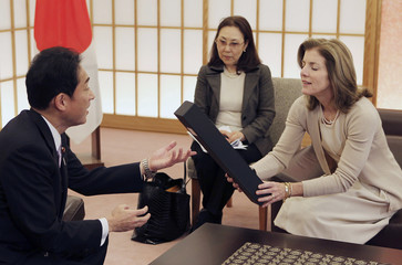 Newly appointed U.S. ambassador to Japan Kennedy is presented a box of specially designed flowers by Japan's Foreign Minister Kishida during their meeting at the Foreign Ministry in Tokyo