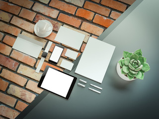 Office supplies with attributes and furniture for office on grey and brick background. 3D illustration.