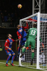 Crystal Palace's Jason Puncheon and Wayne Hennessey try to keep the ball out of the net