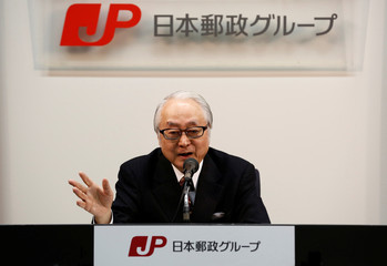 Japan Post Holdings' CEO Masatsugu Nagato speaks at a news conference in Tokyo