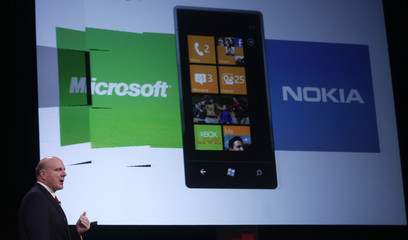 Microsoft's CEO Steve Ballmer gestures during a conference at the GSMA Mobile World Congress in Barcelona