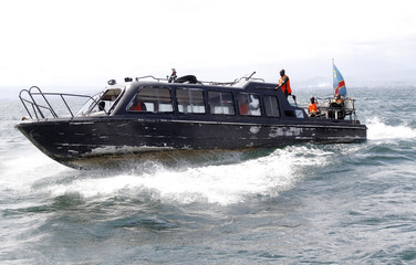 Congolese soldiers use their boat to search for passengers of a boat that capsized in Lake Kivu near Goma in eastern DRC