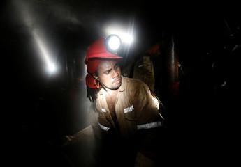 Miner works deep underground at Sibanye Gold's Masimthembe shaft in Westonaria