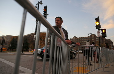 U.S. Republican presidential candidate Michael Petyo stands outside a secure barricade hoping to get admission to a Republican presidential debate in Milwaukee