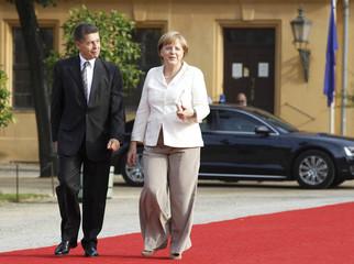German Chancellor Merkel and her husband Joachim Sauer arrive for a dinner at Charlottenburg Castle in Berlin