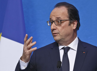 French President Francois Hollande gestures as he speaks during the inauguration of the Institut Pierre-Gilles de Gennes at the School of Industrial Physics and Chemistry in Paris