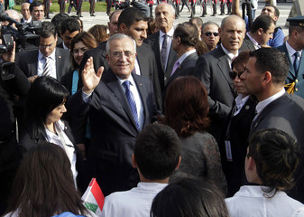Lebanon's President Sleiman waves after meeting with Uruguayan President Mujica at presidential house in Montevideo