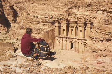 Traveler looking at the Ad Deir (Monastery) Petra, Jordan.