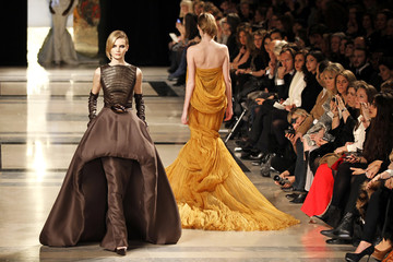 Models present creations by French designer Stephane Rolland as part of his Haute Couture Spring-Summer 2011 fashion show in Paris