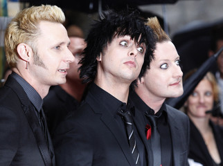 Musicians Mike Dirnt,  Billy Joe Armstrong and Tre Cool of the band Green Day arrive for the American Theatre Wing's 64th annual Tony Awards ceremony