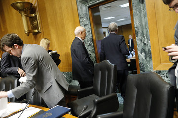 Koskinen departs with Baucus after his testimony before a Senate Finance Committee confirmation hearing on his nomination to be commissioner of the Internal Revenue Service (IRS) was cut short on the Capitol Hill in Washington