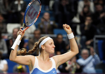 Kvitova celebrates as she wins her Paris Open tennis tournament final match against Clijsters