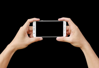 Hand holding mobile smartphone with blank screen. Mobile photography concept. Isolated on black.