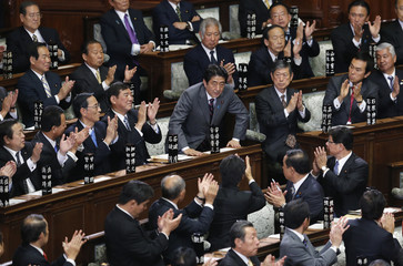 The leader of Liberal Democratic Party (LDP) Shinzo Abe is applauded by his party members after being elected as Japan's Prime Minister in Tokyo
