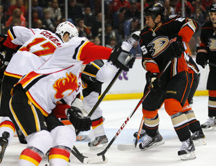 Ducks Staubitz  is hit in the face by the skate of Flames left Tanguay during the first period of their NHL hockey game in Anaheim