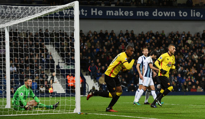 Watford's Christian Kabasele celebrates scoring their first goal as West Bromwich Albion's Ben Foster looks dejected