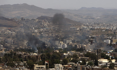 Smoke rises during clashes between police forces and armed tribesmen loyal to tribal leader Shiekh Sadiq al-Ahmar near his house in Sanaa