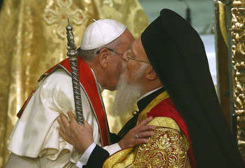 Ecumenical Patriarch Bartholomew I of Constantinople kisses Pope Francis during Ecumenical Prayer in Patriarchal Church of Saint George in Istanbul