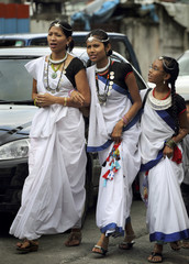 Indigenous Tharu girls from South Nepal arrive to take part in the International Day of the World's Indigenous People in Kathmandu