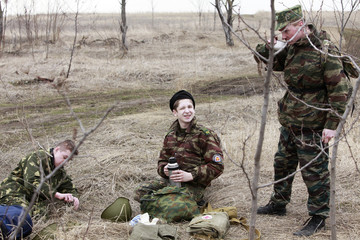 Students from the Yermolov Cadet School rest during a training march near the southern Russian city of Stavropol