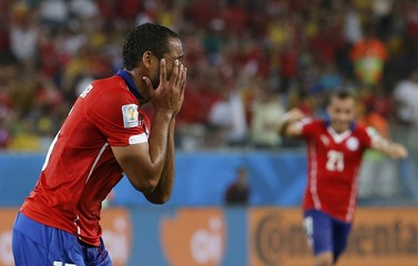 Chile's Beausejour celebrates after scoring against Australia during their 2014 World Cup Group B soccer match at the Pantanal arena in Cuiaba