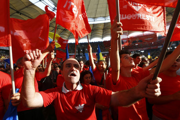 Supporters of Ponta, Romania's Prime Minister and leader of Social Democrat ruling party, attend a rally at the National Arena stadium in Bucharest