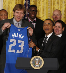 U.S. President Obama receives jersey from 2011 NBA champions Dallas Mavericks at the White House in Washington