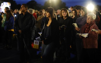 Pilgrims attend a prayer vigil led by Pope Benedict XV at Hyde Park in London