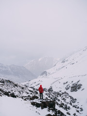Anonymous person in snowy mountains