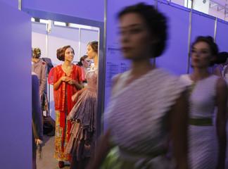 Models wait backstage during Ukrainian Fashion Week in Kiev