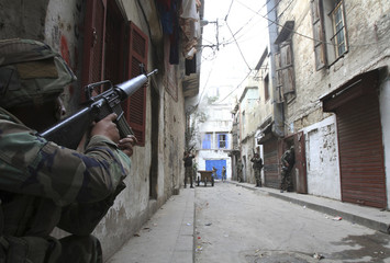 Lebanese army soldiers patrol the Sunni Muslim Bab al-Tebbaneh neighbourhood after being deployed to tighten security