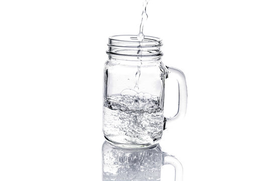 mason jar with water isolated on white