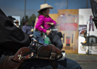 Rosen of Edima, Minnesota, draws and fires as a colleague with his holstered gun watches from behind during the Canadian Open Fast Draw Championships in Aldergrove