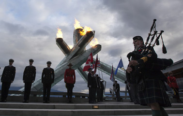 The Olympic Cauldron is lit during Remembrance Day ceremonies in Vancouver