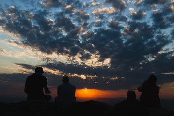 People silhouettes at sunset in Brazil