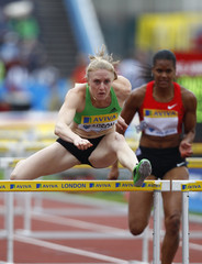 Sally Pearson of Australia competes in and wins the women's 100m hurdles during the London Grand Prix, Diamond League, athletics meeting at Crystal Palace in London
