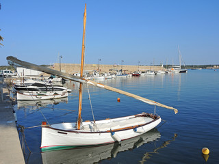 Port de Fornells, Menorca, Spain. Boats at the harbor
