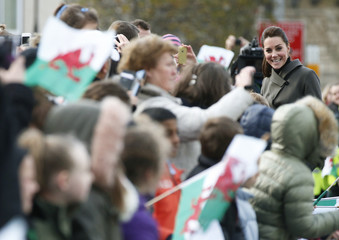 Britain's Catherine, Duchess of Cambridge, smiles as she speaks with wellwishers during a visit to Caernarfon in Wales
