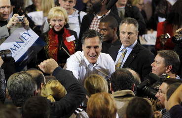 U.S. Republican presidential candidate and former Massachusetts governor Mitt Romney greets supporters at a campaign rally in Charleston
